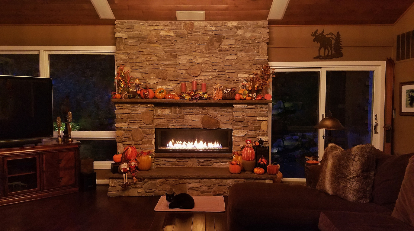 Fireplace with pumpkin decorations for the fall season